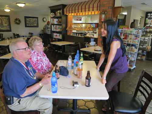 Manager, Sharon Schmidt, greets the Glicks