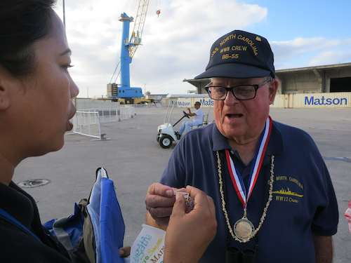 Port police officer, Frances, confers a special pin as a show of fellow police officer camaradery to Lloyd
