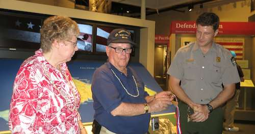 Judy, Lloyd receiving a Veteran's Commemorative medal from the Park Service's Ben Hayes and James Oelke (not shown